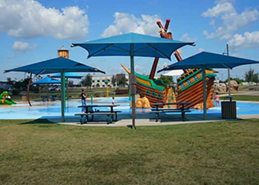 Shaded picnic tables at an outdoor water park