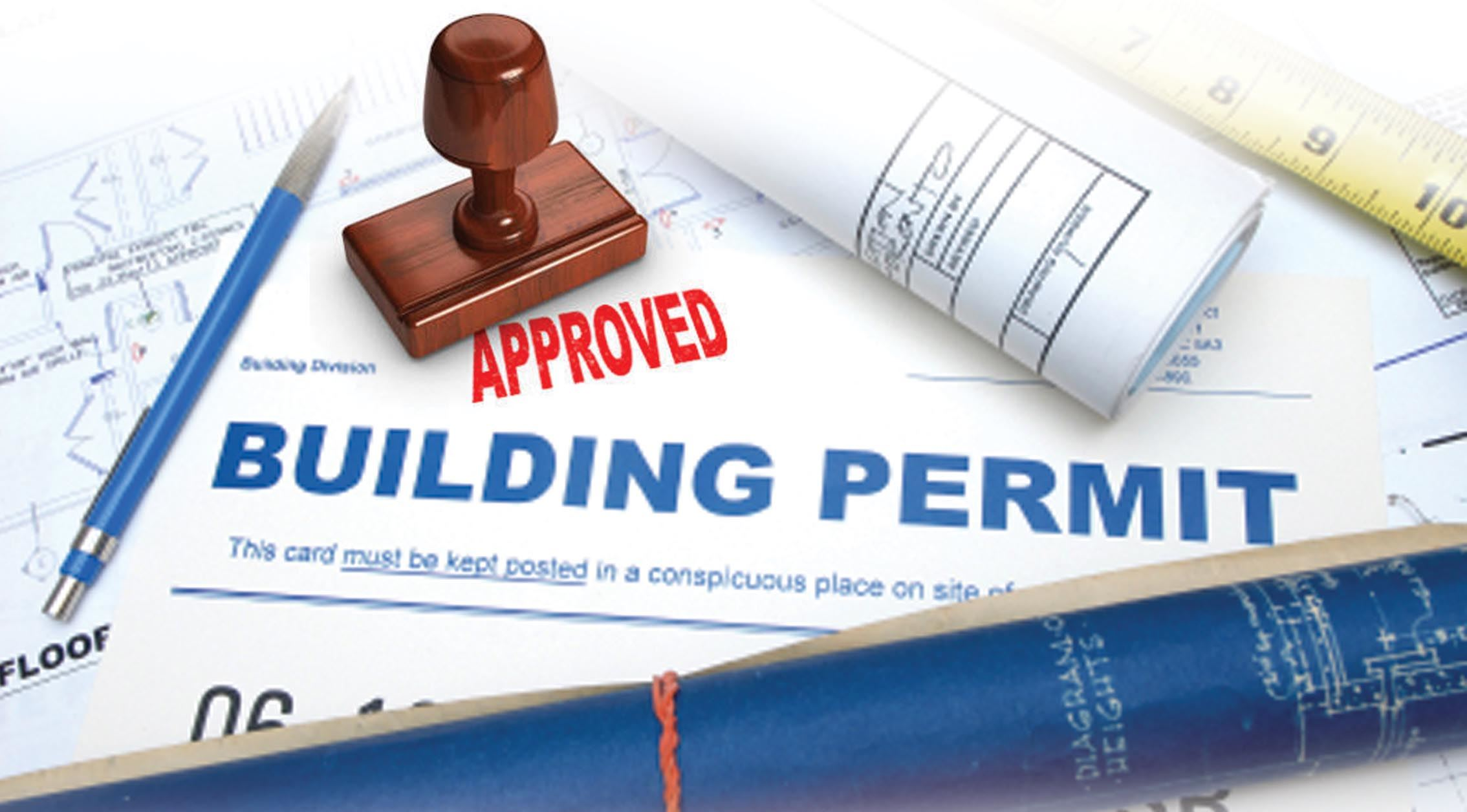 Blueprints and a building permit stamped approved