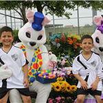 twin boys have their picture made with the Easter Bunny at Mont Belvieu City Park